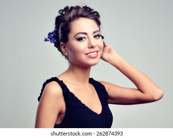 girl with beautiful hair and bright makeup in the evening wear flowers in the hair beautiful woman