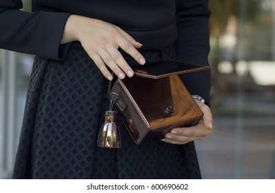 Girl with beautiful hands holding hand bag