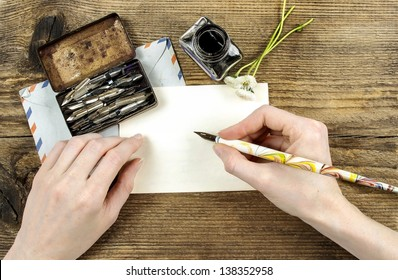 Girl with beautiful hands writing a letter