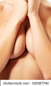 Girl with beautiful nude breasts covered herself