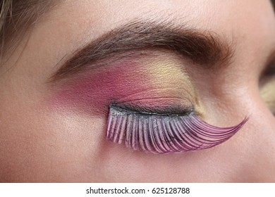 Girl with beautiful pink false eyelashes