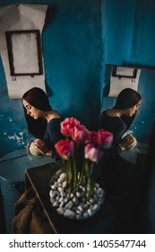 The girl in a beautiful room with blue walls