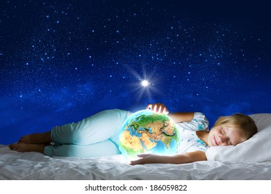 Girl in bed with Earth planet in hands. Elements of this image are furnished by NASA