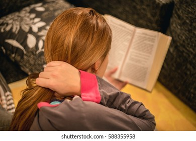 Girl in bed reading a book