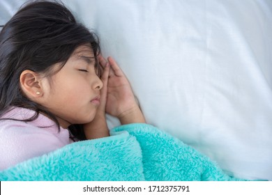 girl in bed resting at home due to coronavirus pandemic in mexic