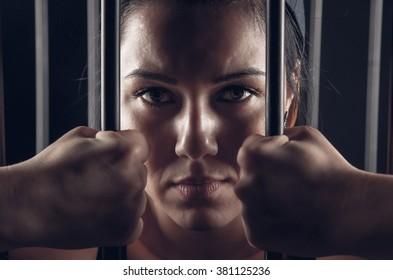girl behind bars in jail