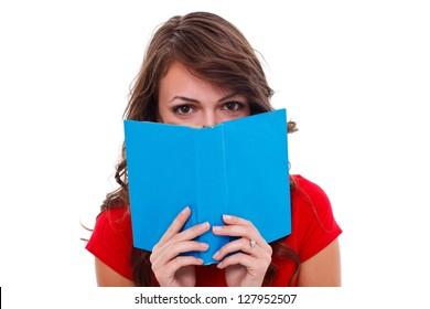 Girl behind colorful book, studio shot