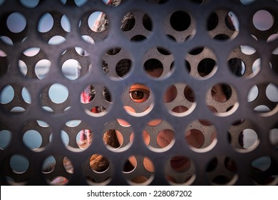 girl behind metal gate