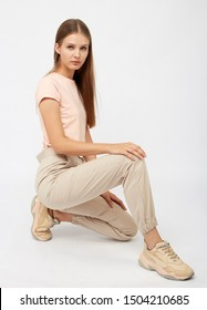 girl in beige cargo pants and a t-shirt