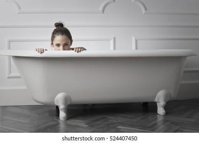 Girl being playful in a bathtub