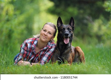 Girl and Belgian dog