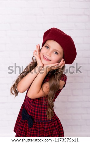 d65de204acb Girl in beret smiling on brick wall background fashion style. Beautiful little  girl in a red beret. Portrait of little girl wearing a beret hat. - Image