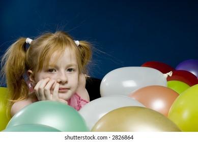 Girl between balloons