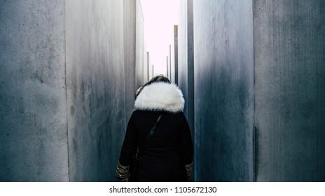 A girl between Holocaust Memorial in Berlin.