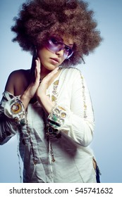 Girl with Big Afro in 70's clothing.
