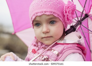 The girl with big eyes with pink umbrella.
