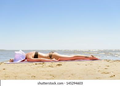 Girl in bikini relaxing on a beach