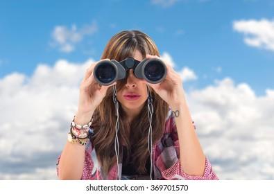Girl with binoculats on unfocused background