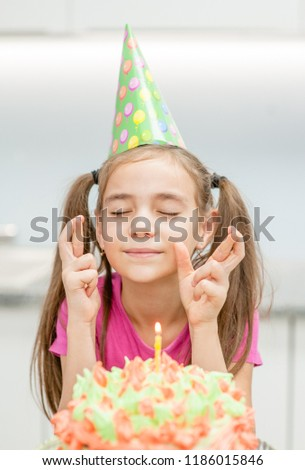 Girl The Birthday Hat With A Cake Candles Makes Wish His Fingers Crossed