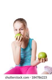 girl biting a green apple