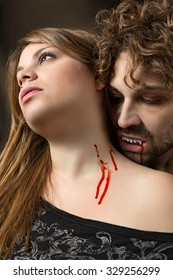girl bitten by a vampire with bloody mouth