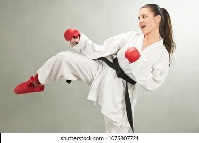 Girl with black belt in karate pose
