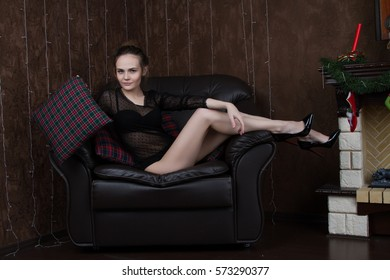 Girl in a black body in the room by the fireplace