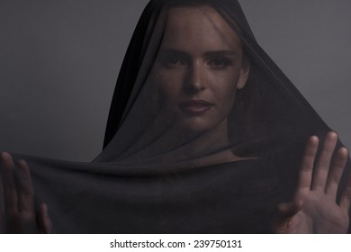 girl with black cloth on the head