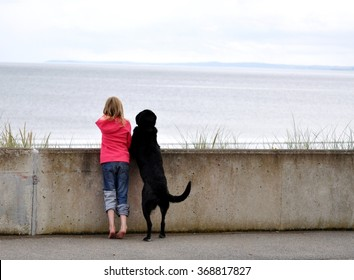 Girl with black dog