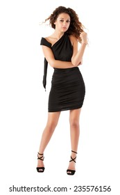 girl in a black dress in the studio on a white background.