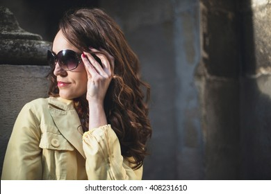 Girl in black glasses looking mysterious