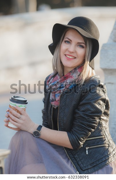 Girl in black hat having a coffee time