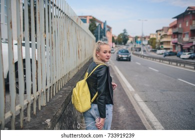 girl in a black leather jacket on the road