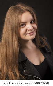 Girl in a black leather jacket, smiling, portrait