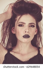 girl with black make up and long laches and hair. black lips. dark lipstick and white skin. fashion beauty model, vogue style portrait of woman on white background
