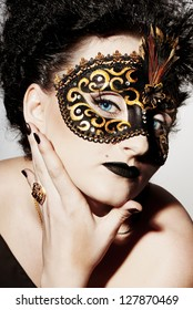 Girl in a black mask and with blue eyes