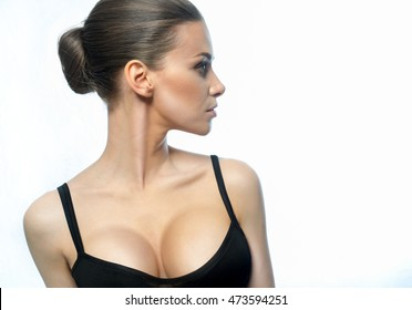 Girl in a black, open shirt, with a beautiful face and an attractive, large breasts, with an unusual look.
