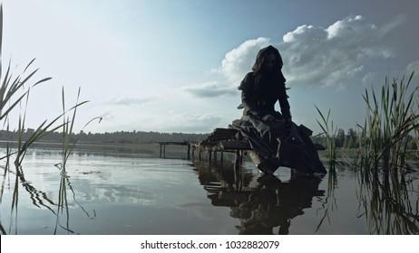 A girl in black rags on an abandoned bridge. Apocalypse. 4k