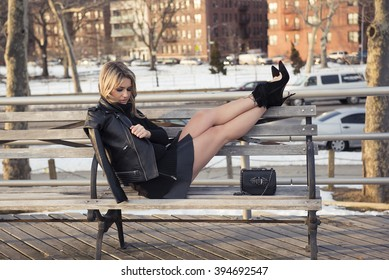 girl in black sweater, skirt and Christian Louboutin shoes