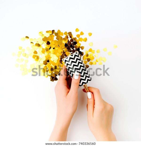 Girl blasts golden confetti