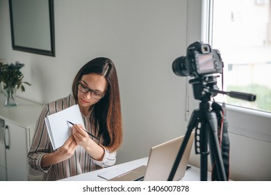 Girl blogger records video for their subscribers. Infobusiness or information business or hobby or online training or education for people. Or language learning