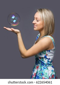 girl blonde with soap bubble on her hand