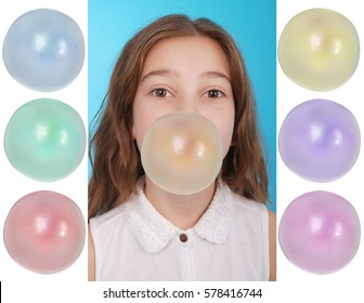 Girl blowing a big bubble gum bubble isolated on blue