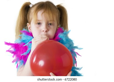girl is blowing a red balloon