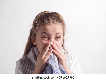 girl blows her nose