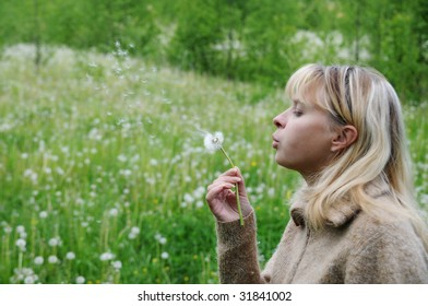 Girl blows on dandelion and thinks desire 1