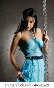 The girl in a blue dress with the bared shoulders.