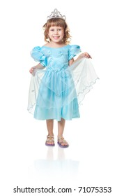 The girl in a blue dress costs on a white background