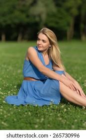 Girl in blue dress enjoying summer day