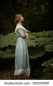 the girl in the blue dress in the garden